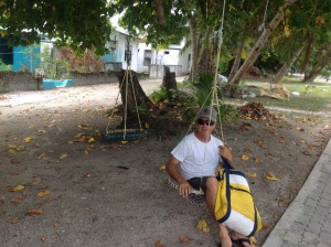 Rest Awhile on an Island pavement swing.