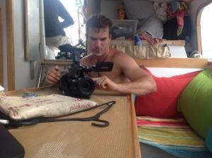Jon Slayer preparing camera equipment.
